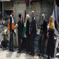 اخراج حوالي الفي شخص من مخيم اليرموك